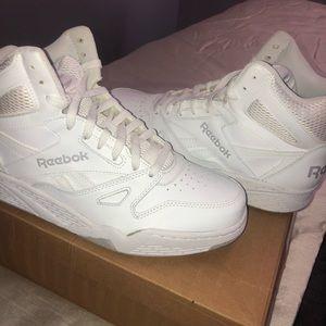 All white Reebok men's sneakers